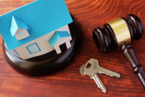 House Auction Real Estate Law concept. Model of house and a gavel.