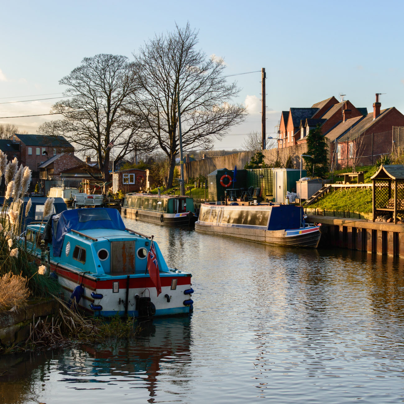 Longboats moored on the River Soar, Zouch, England.